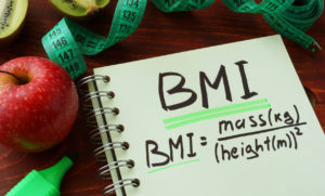 BMI body mass index written on a notepad sheet.