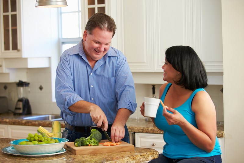 Couple cooking a healthy meal together