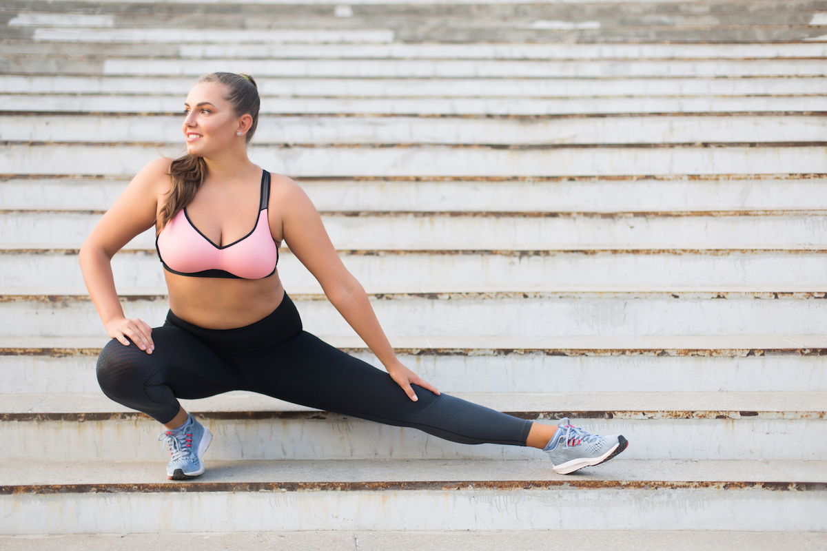 Woman stretching on a staircase before a run